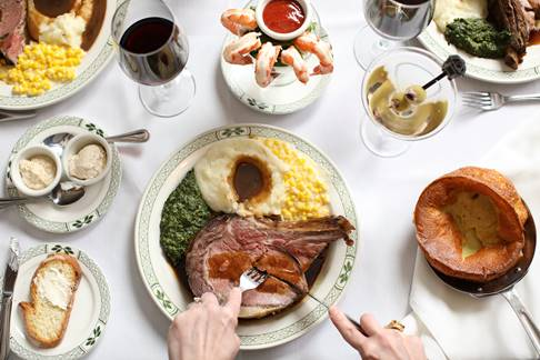 Larey sets the table for Chicago Restaurant Week. (Photo courtesy of Lawry's)