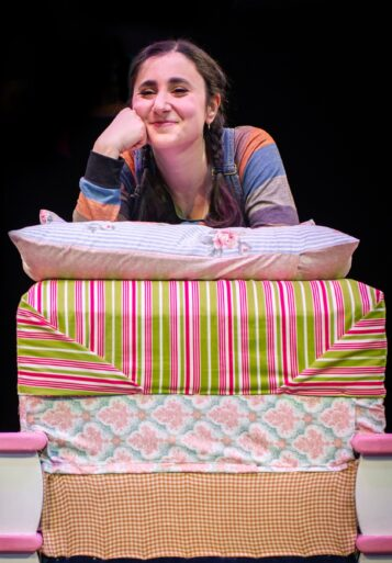 Ruth (Marielle Nada Issa) finds it hard to sleep in The Princess and the Pea. (Photo courtesy of Marriott Theatre)