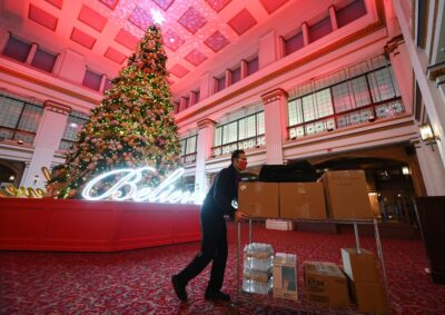 Walnut Room Manager Gino Tarallo loads up with food packages for front-line works. (Photo by Daniel Boczarski/Getty images)