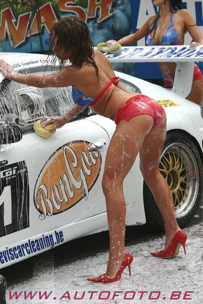 brunette washing car in red hot pants