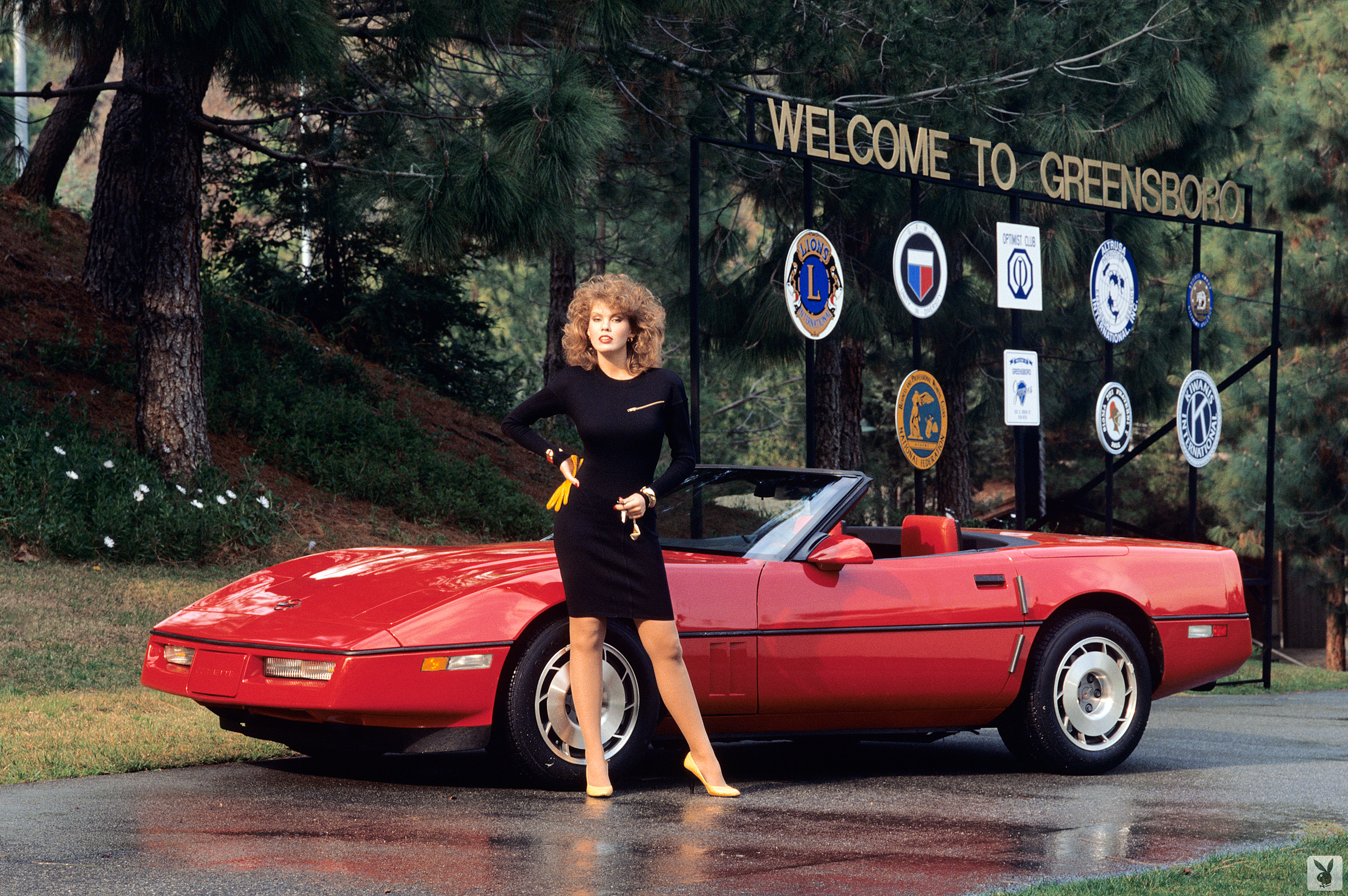 sexy 80s girl with red corvette convertible