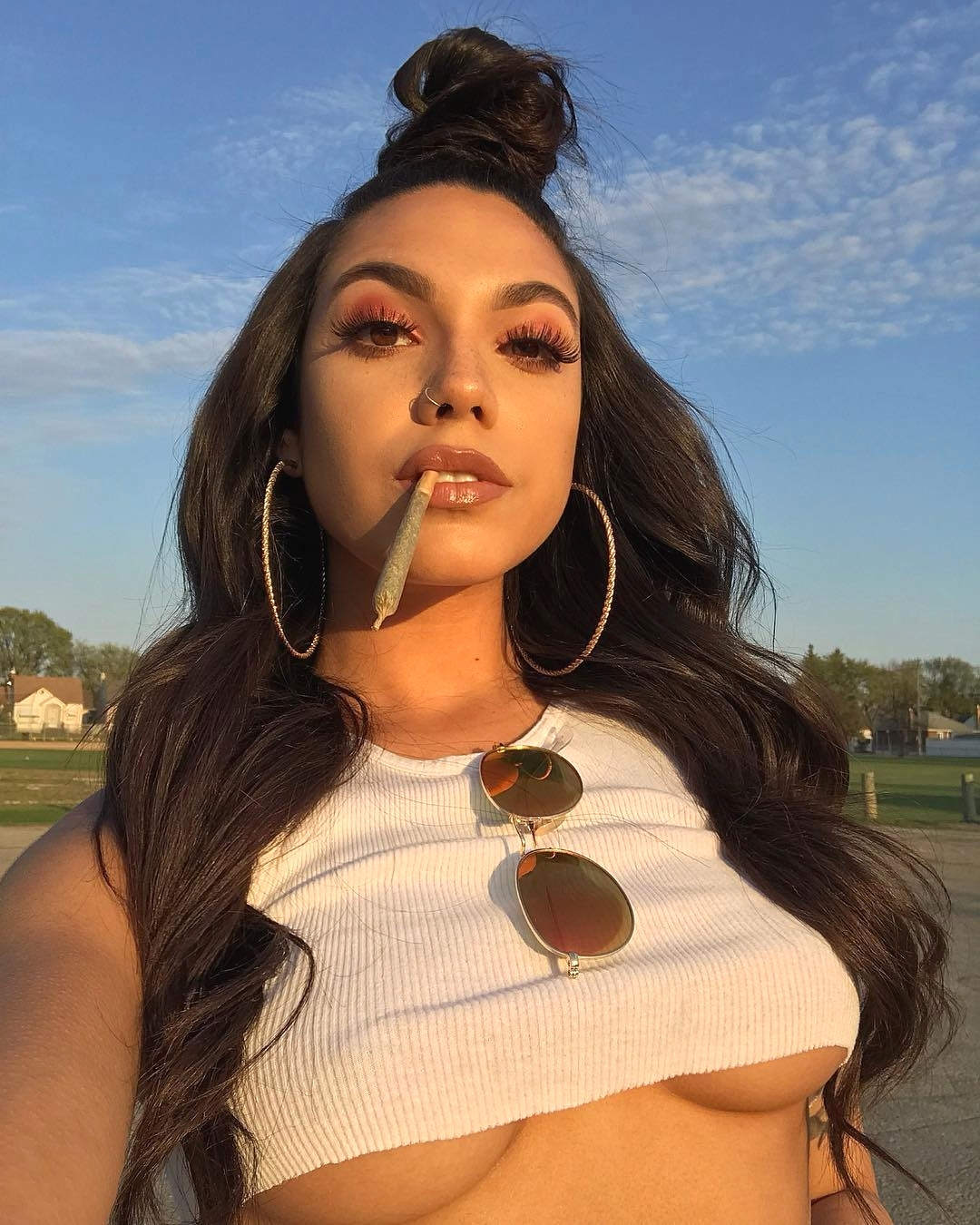 cannabis babe with blunt and halter top