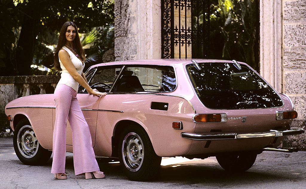 brunette babe with classic pink car