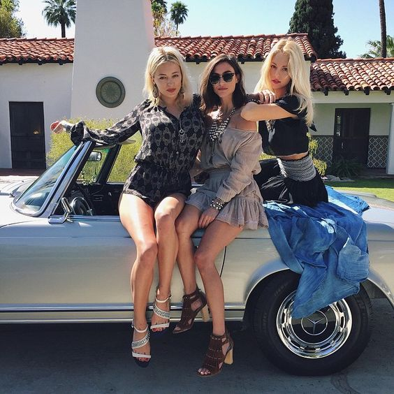 three hot babes in a mercedes convertible