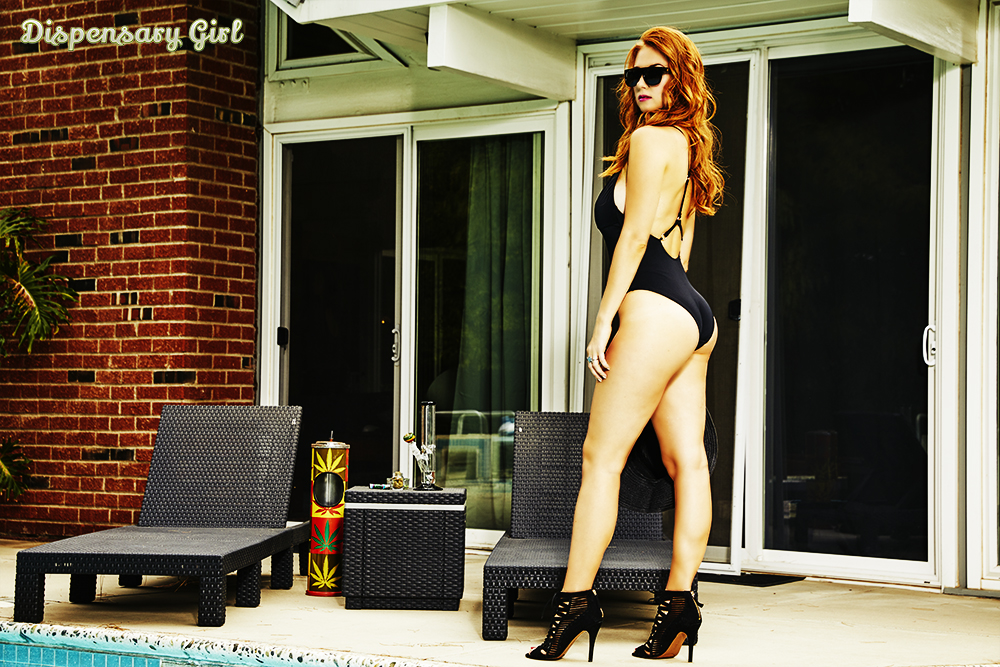 dispensary girl model inessa in black by pool with bong