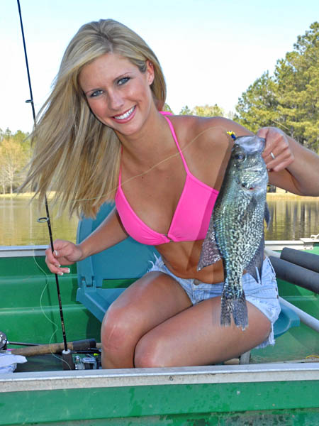 cute girl holding cute fish and rod
