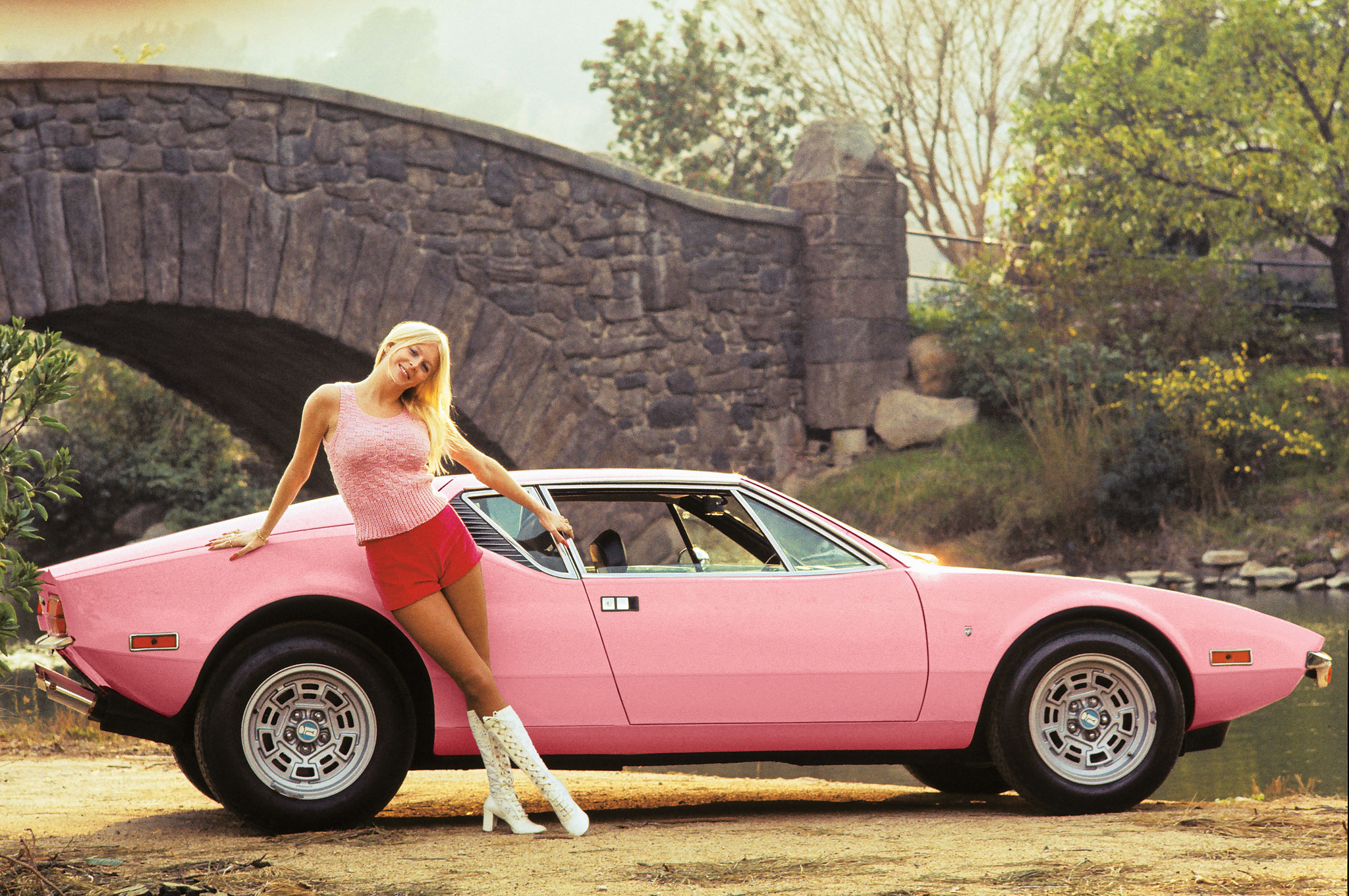 girl with red shorts and pink car