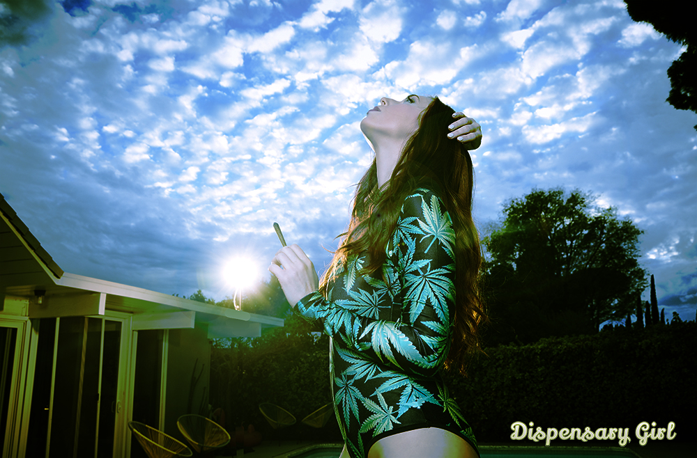 pretty redhead smoking weed in weed jumpsuit at sunset