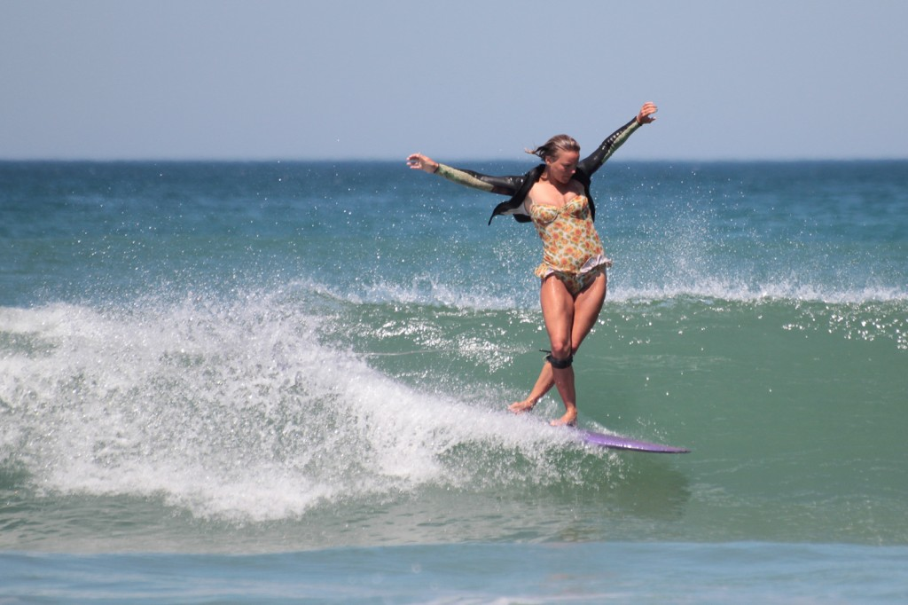girl just learning how to surf goofy foot
