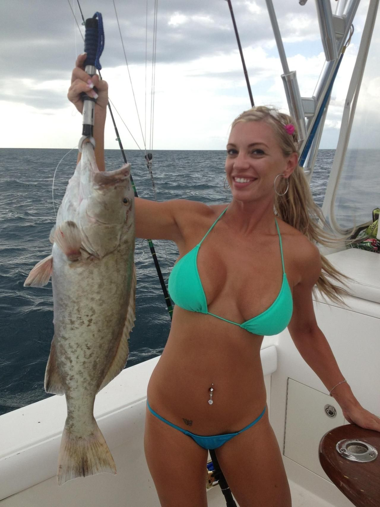 beautiful girl with huge fishes