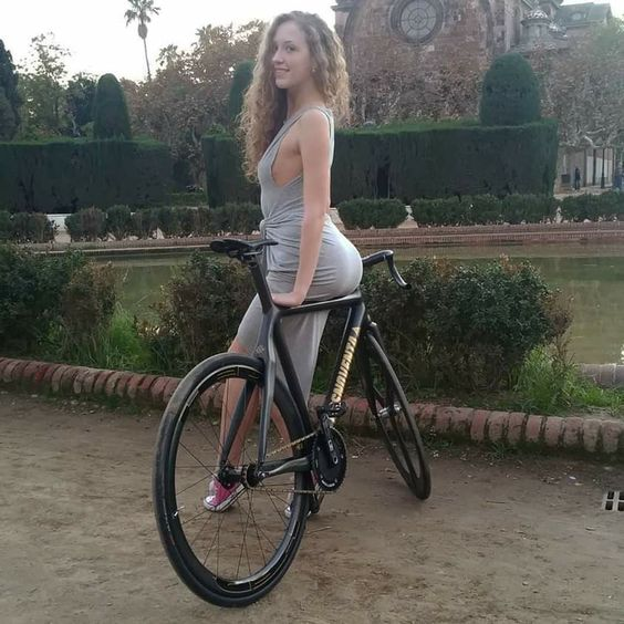 cute babe with tight gray dress on bike great ass