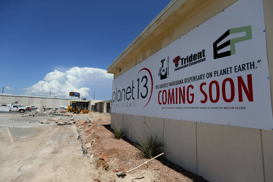 coming soon sign planet 13 cannabis dispensary