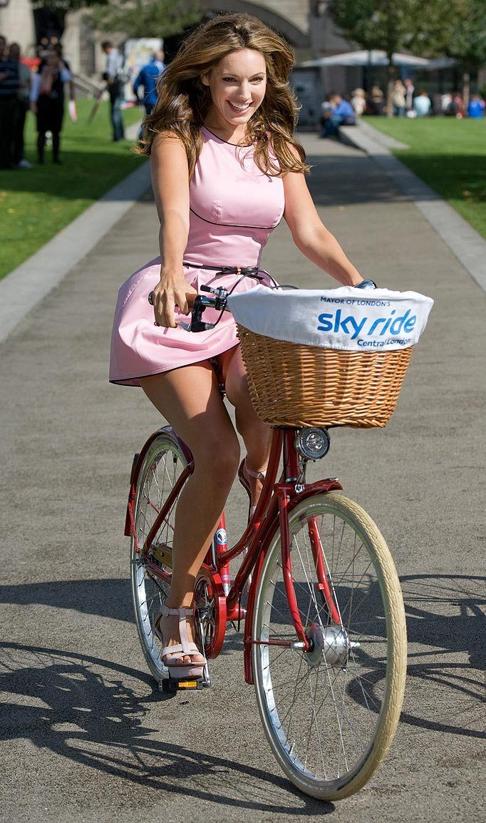 busty babe kelly brook in pink on bicycle sexy hot fun