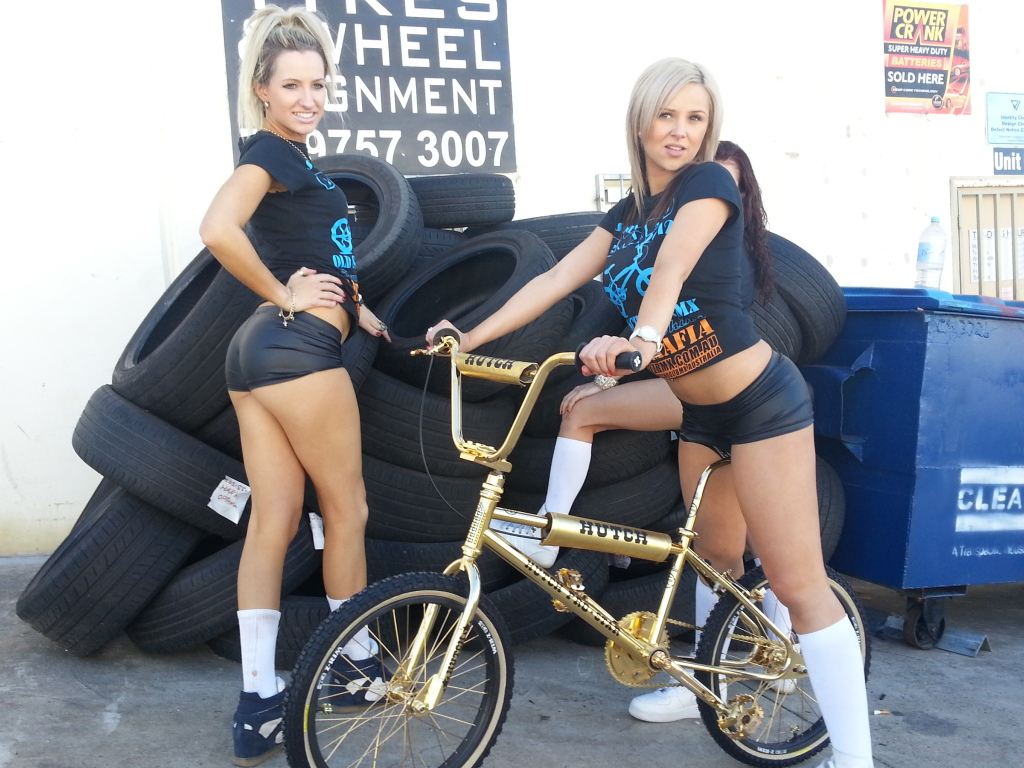 girls in black dolphin shorts on gold bicycle hot sexy fun