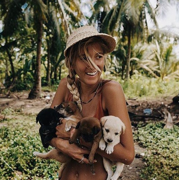 super cute girl with four puppies on a vacation