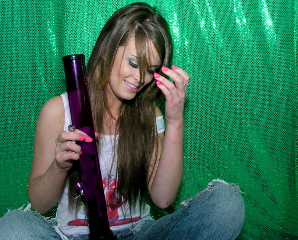 fun stoner chick with pink fingernails getting stoned high