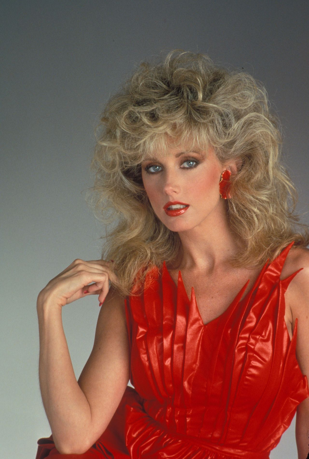 morgan fairchild 80s babe teasted hair red dress