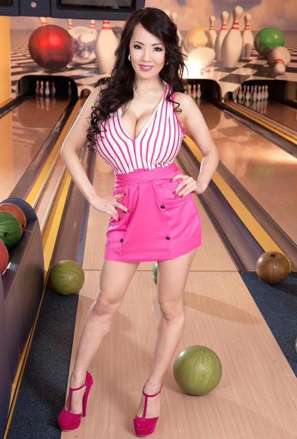 asian at bowling alley pink skirt and stripes