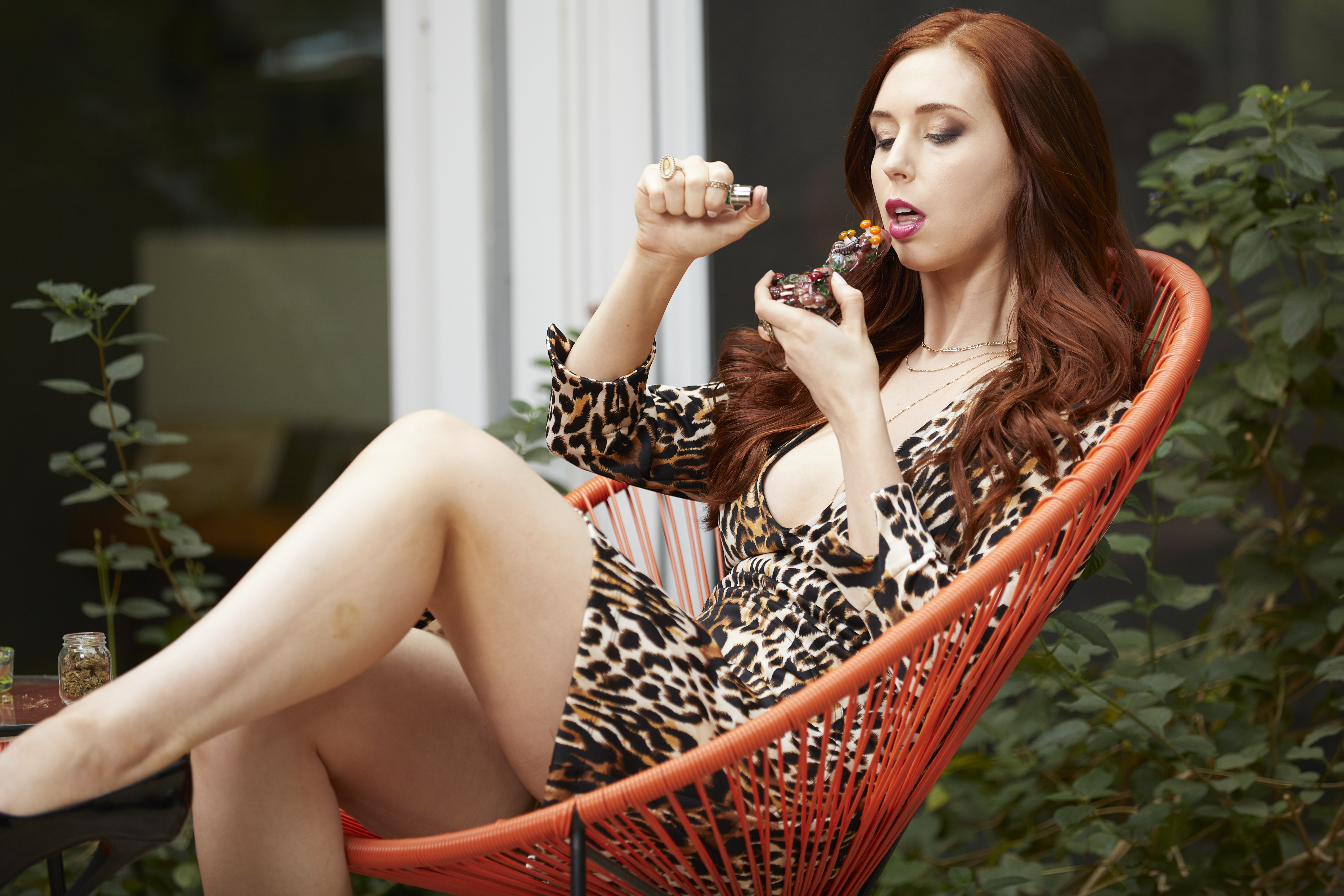 redhead babe getting high in orange chair