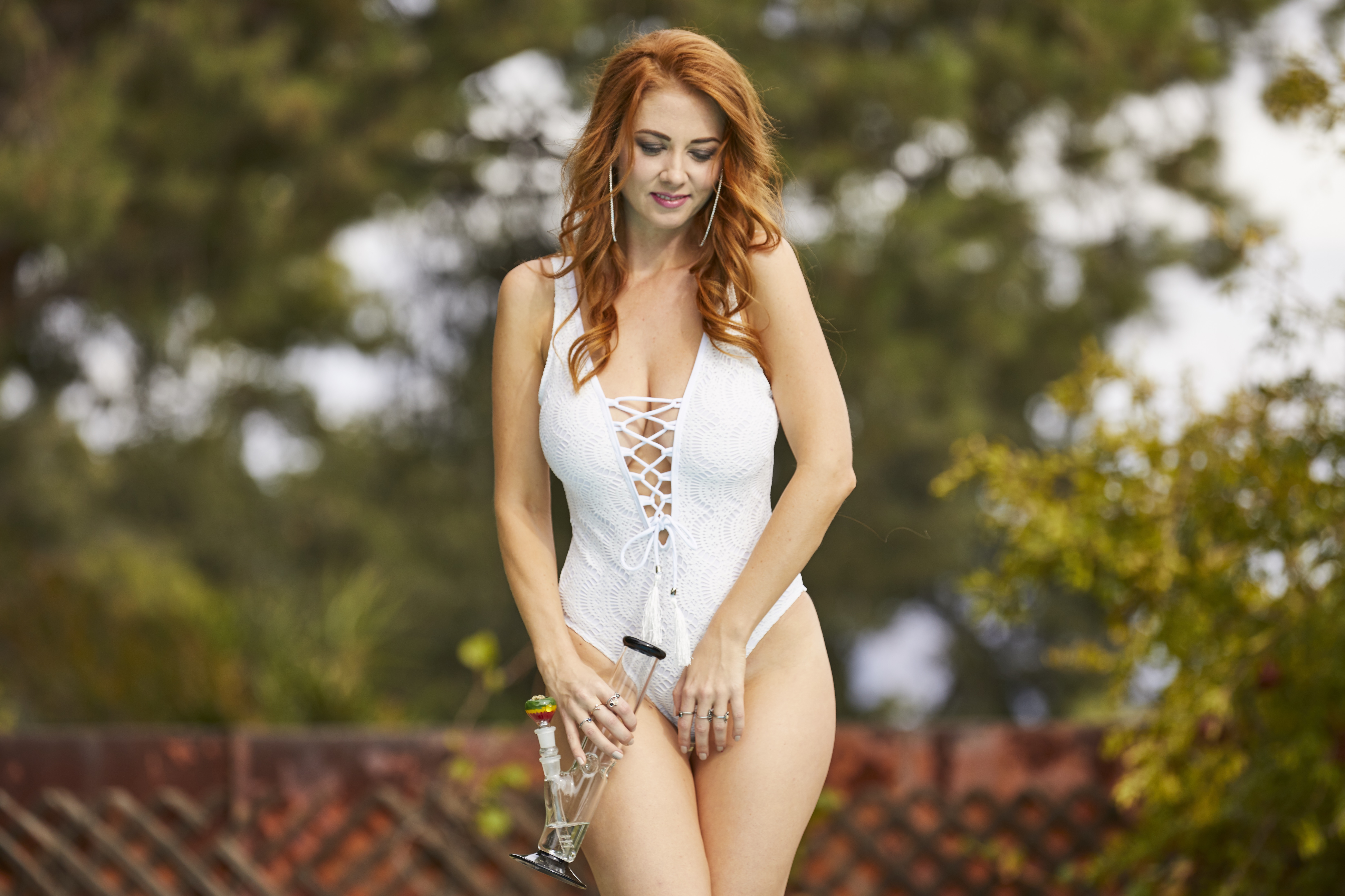redhead hotty by the pool poolside with a bonger