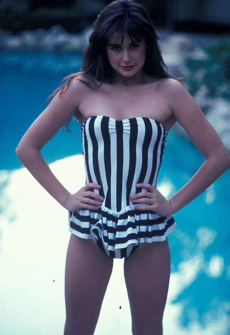 young demi moore in striped bikini
