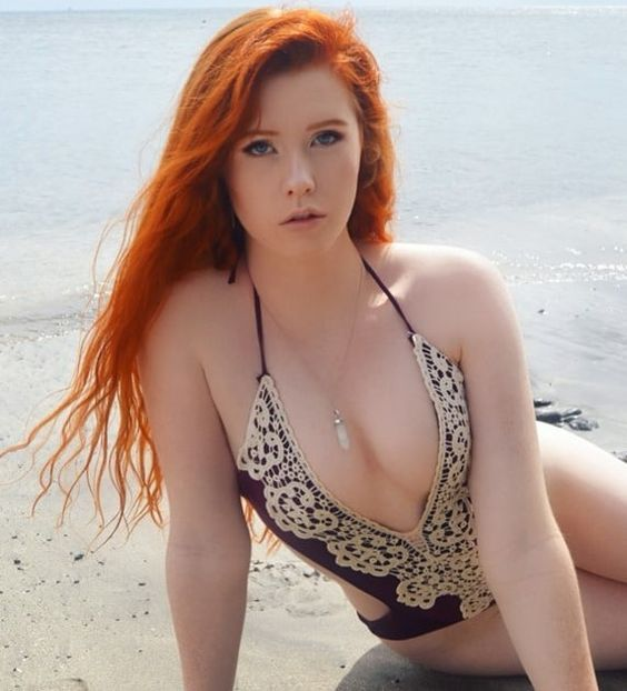 redhead hotty showing some skin at the beach