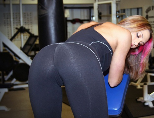 girl bending over in yoga pants at the gym