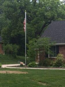 A house with a US flag on a flag pole