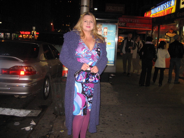 Martha Hayden Woods in New York Times Square wearing a dress and carrying a purse in the Rosone print from Matthew Williamson for Pucci 2007:08 collection. Image: supplied by Martha