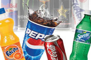 Sugary and acidic soft drinks that wear down the enamel of teeth