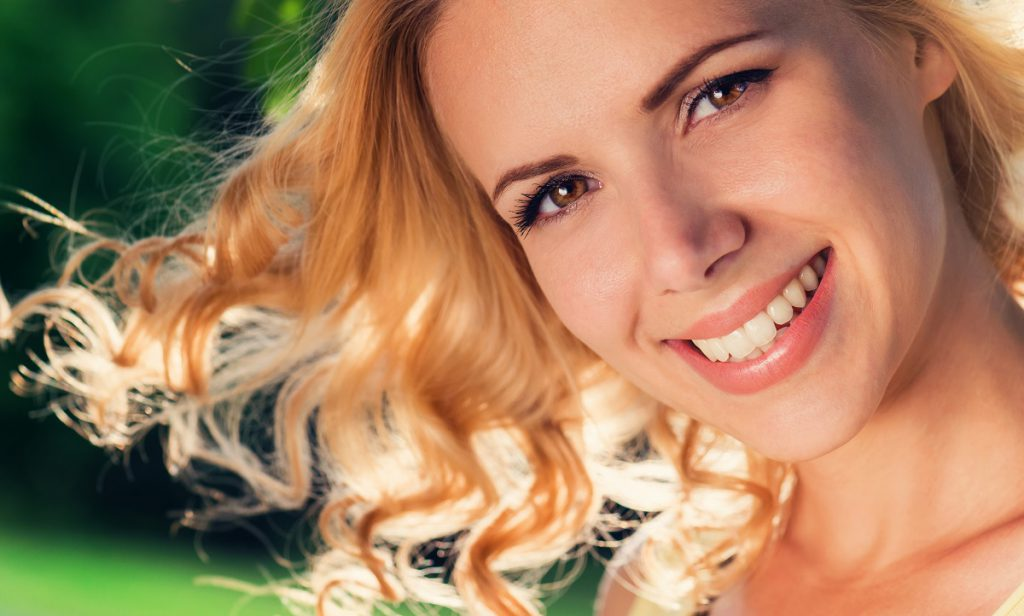Women who is not a teeth whitening candidate smiling