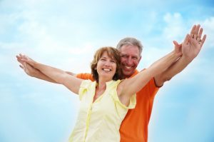 Older couple smiling with dentures