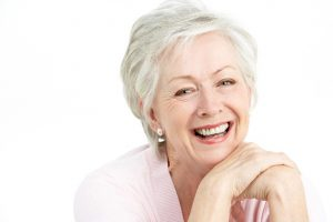 Patient who was fitted for dentures at Cobblestone Park Family Dentistry