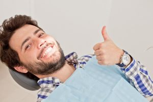 Man excited to receive restorative dental services