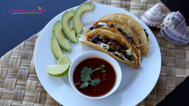 These vegan beef and black bean tacos are meaty without the meat! Beyond Meat Beef Crumbles stand in for a delicious meatless taco.
