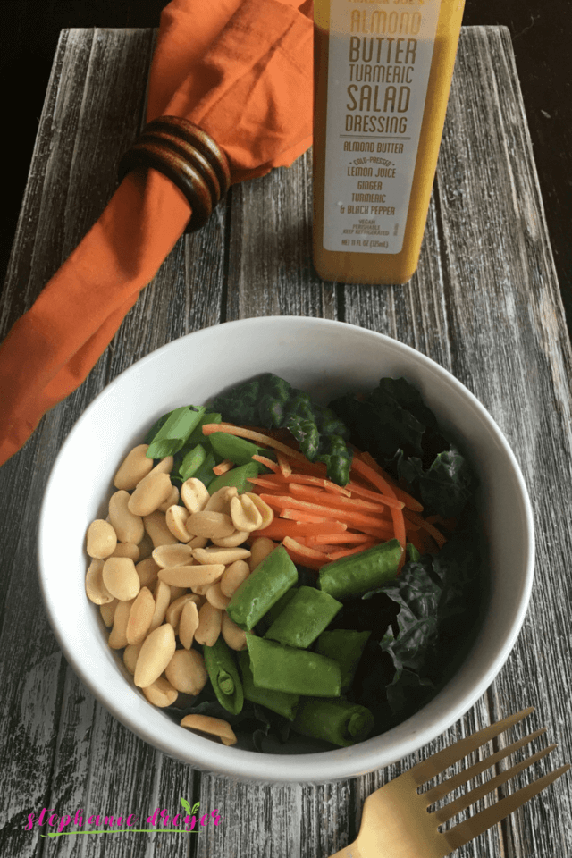 This Carrot Noodle Bowl with Almond Butter Turmeric Dressing is crunchy and satisfying - and all you need is 10 minutes and 5 ingredients! #veganbowl