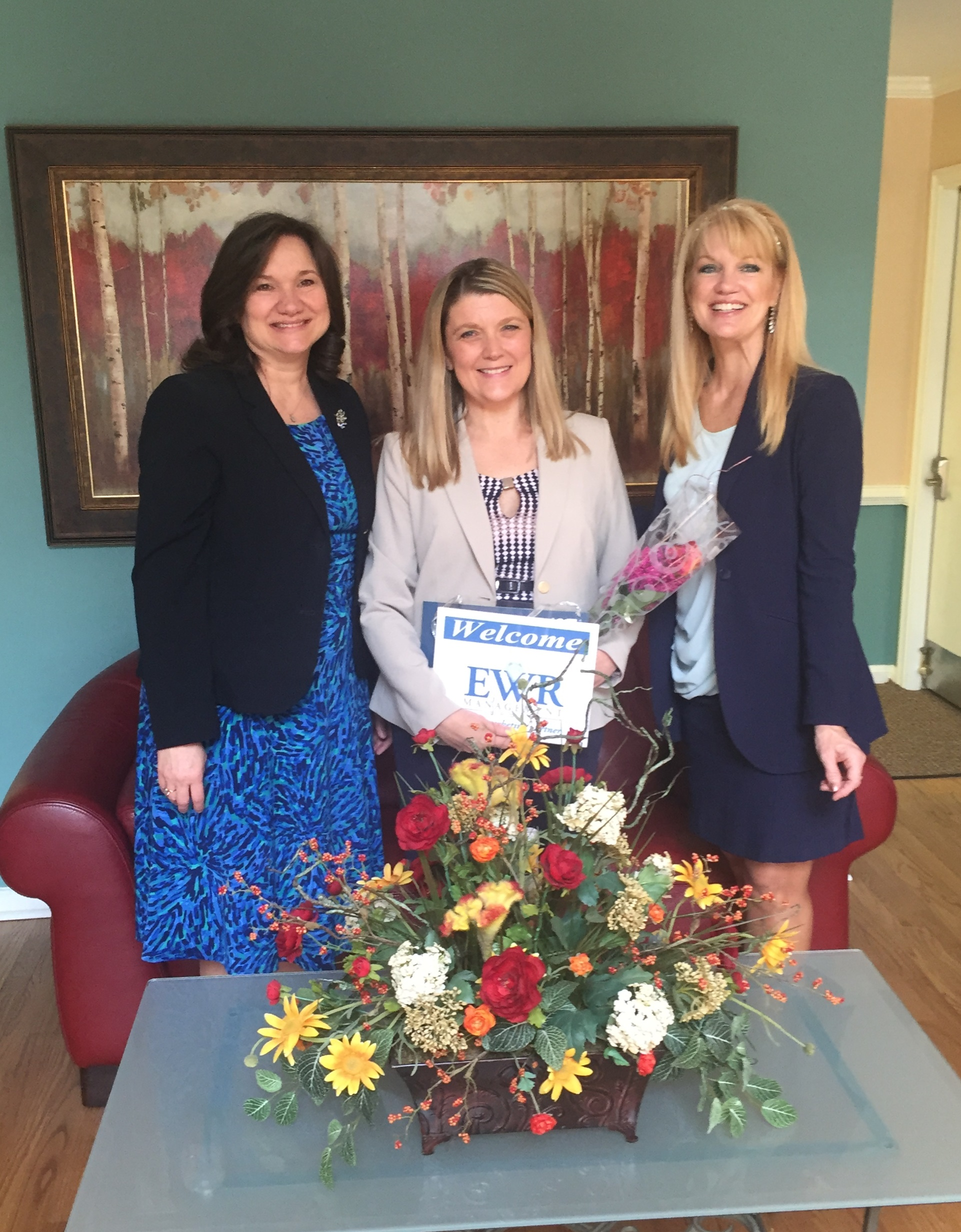 Shannon Kane, Virginia Beach City Councilwoman and President/Chief Marketing Partner of EWR Management Group is surprised by Hampton Roads Chamber of Commerce Executive Vice President of Operations, Sylvia Haines and Senior Vice President of Programs and Communications, Priscilla Monti with the 2016 Small Business Leader of the Year Award. Kane will be honored at the Chamber's annual Small Business of the Year awards luncheon on May 24th.