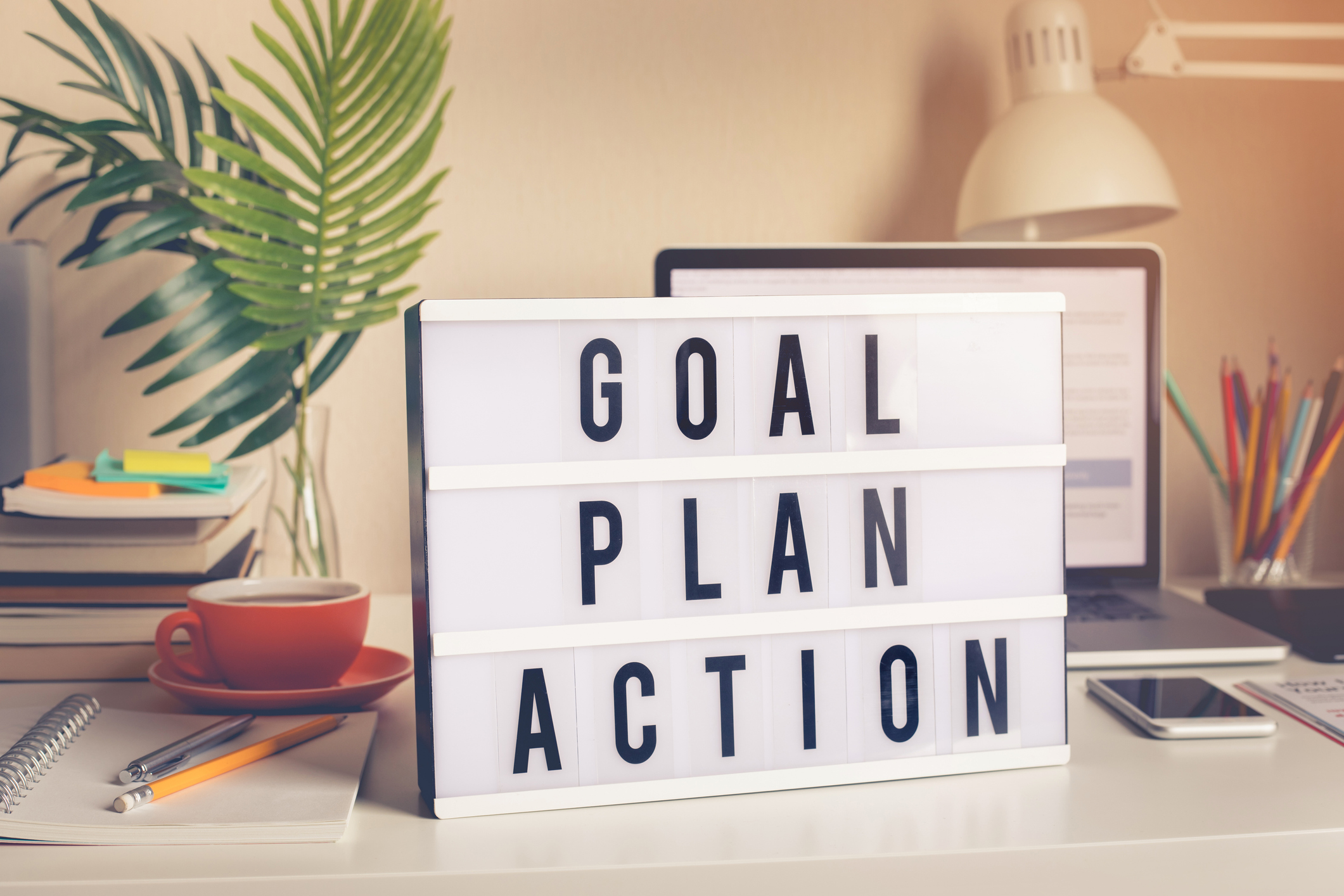 Goal,plan,action text on light box on desk table in home office.Business motivation or inspiration,performance of human concepts ideas