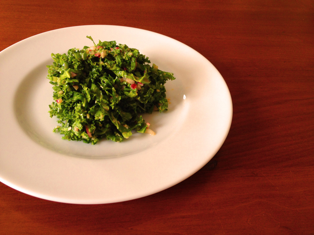 Kale Slaw with Sesame Honey Dijon Dressing. For an additional touch, serve with a small, crisped piece of thick-cut bacon, crisped bacon pieces. Photo © Ben Young Landis.