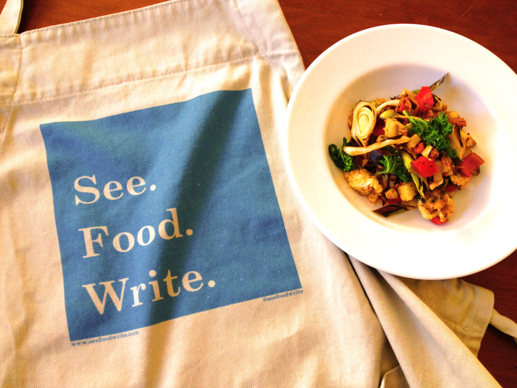 Sponsors at the Patron tier during the Winter 2016 Writing Season received our See. Food. Write. logo apron. Photo © Ben Young Landis.