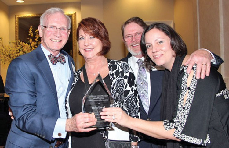 Lew Parker earns the Gordon Murchie Lifetime Achievement Award in 2013. (Left to right) Lew Parker, Susan Mitchell, tasting room manager, Dean Triplett, operations manager, Kelly Peck, administrative director.