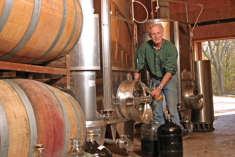 Lew taking a tank sample from one of his award winning wines.