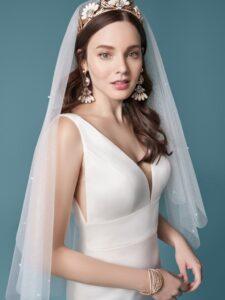 A white, simple V-neck satin sheath wedding dress.