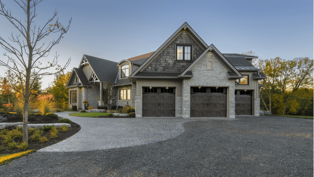 Image of a home with three separate garage doors.