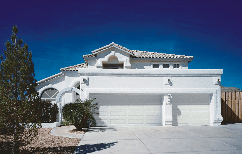 Picture of a large home with two garage doors.