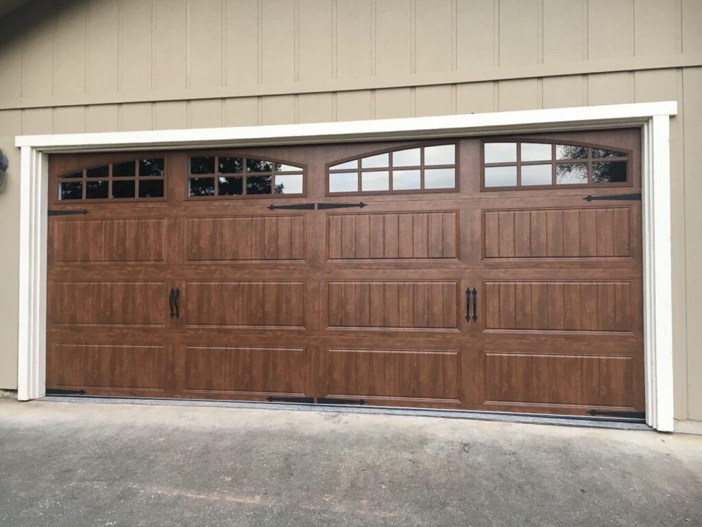 picture of a wood look new garage door.