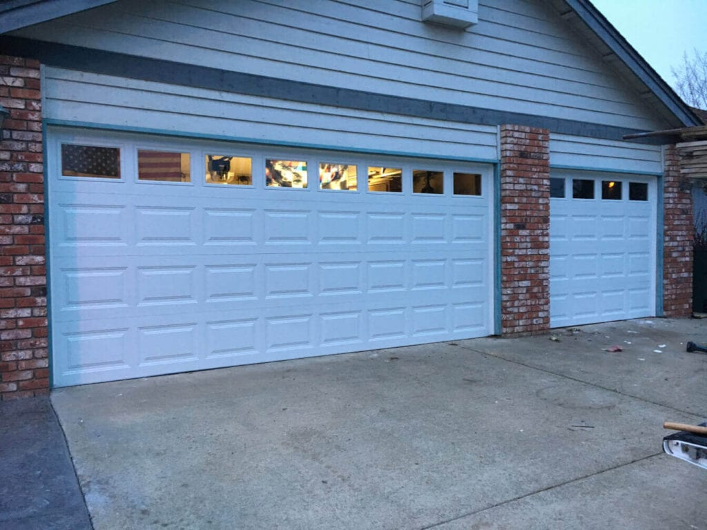 Image of a double and single garage door installed in a home.