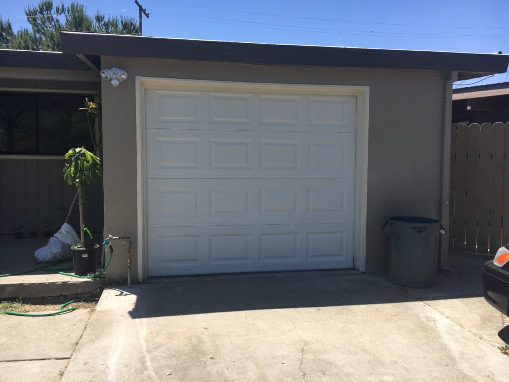 image of a garage door installed in a home.