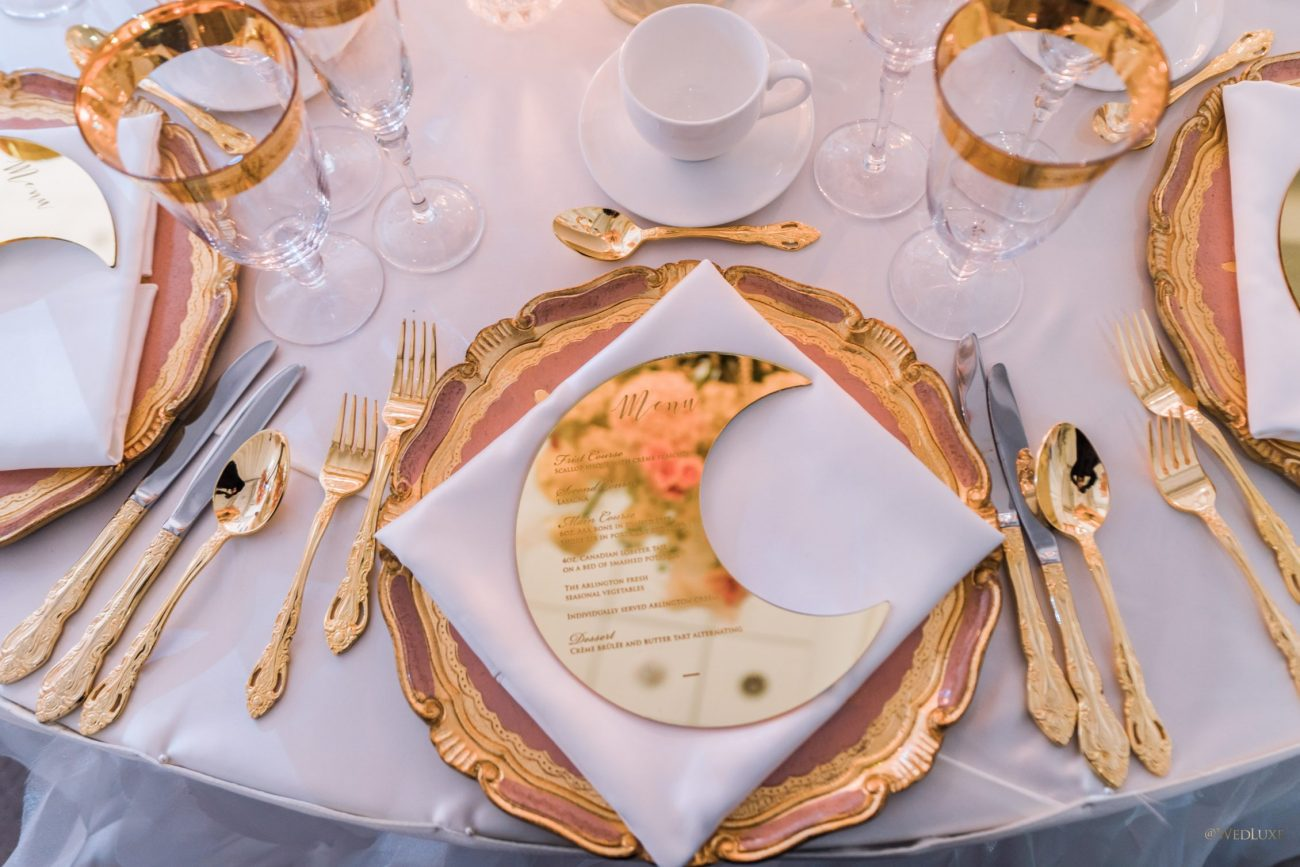 golden half moon menu with gold cutlery and plates