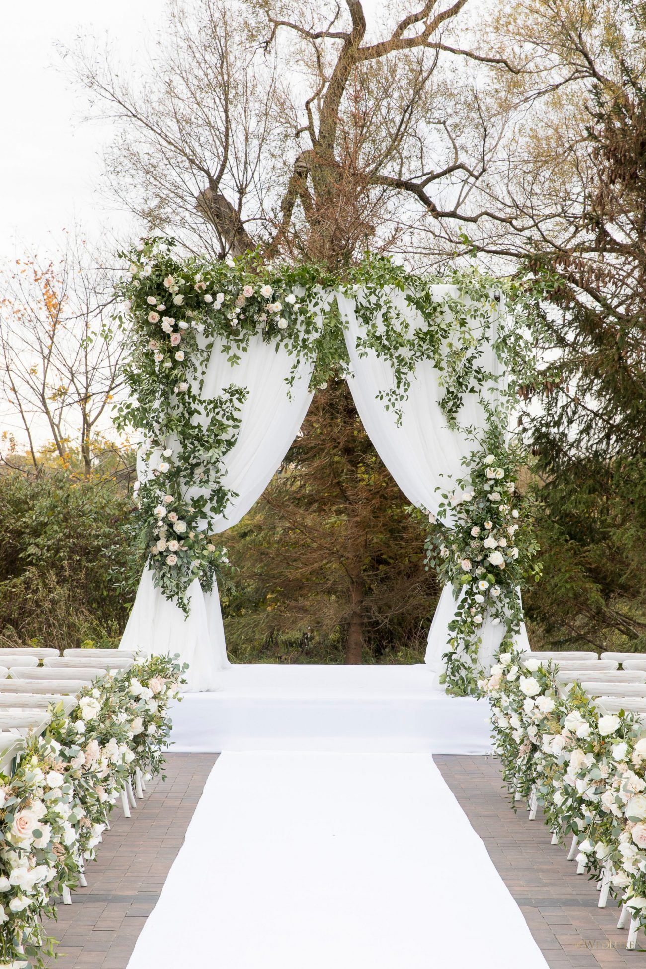 Outdoor ceremony blush and green wedding decor
